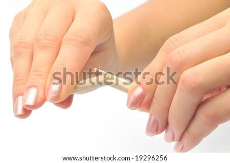 woman hands breaking wooden pencil - stock photo