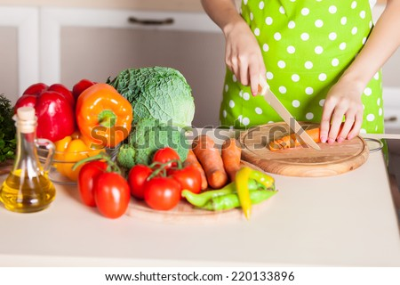 woman hands cooking vegetables salad in kitchen - stock photo