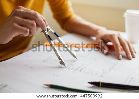 Woman hands doing technical drawing - stock photo