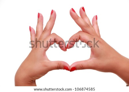 Woman hands gesturing heart sign