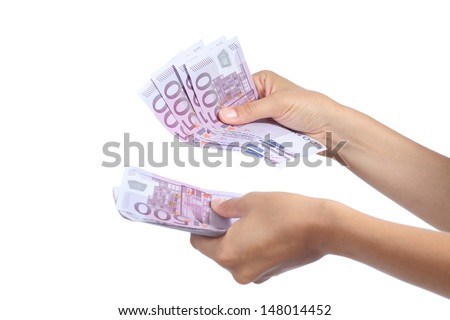 Woman hands holding and counting a lot of five hundred euros banknotes isolated on a white background