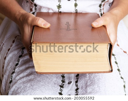 Woman hands holding Holy Bible - stock photo