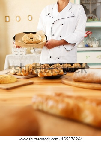 Woman hands holding plate with homemade baked goods