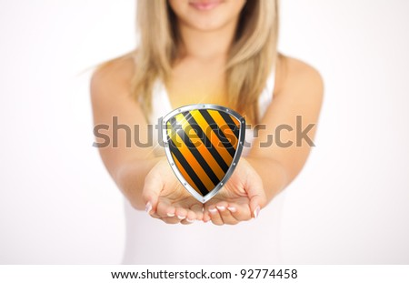 Woman hands holding protective shield - stock photo