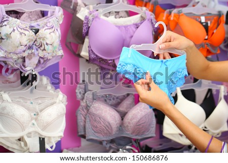 Woman hands in shop with underwear