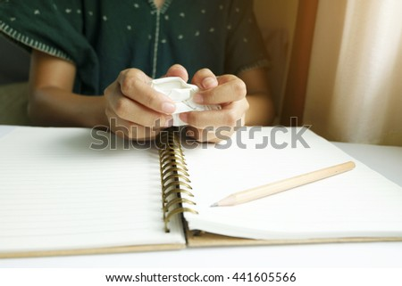 woman hands make up set with  paper and making paper ball after mistake during writing