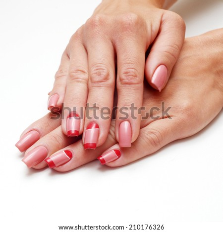 woman hands on long nails covered with red lacquered