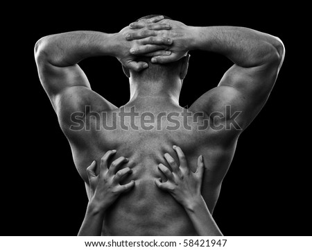Woman hands plunging her nails into a man's back, conceptual shot, monochrome - stock photo