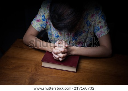 Woman hands praying with a bible - stock photo