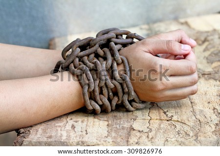 woman hands tied up with chain , Human rights violations concept - stock photo