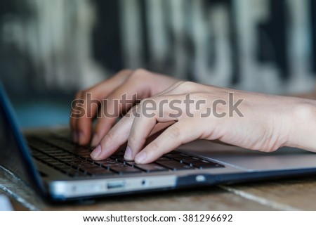 Woman hands typing on computer keyboard - stock photo