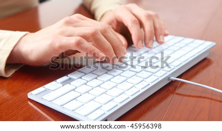 Woman hands typing on the white keyboard - stock photo