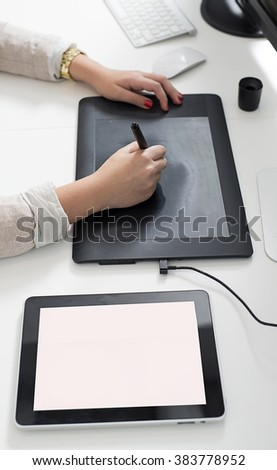 Woman hands using a graphics tablet - stock photo