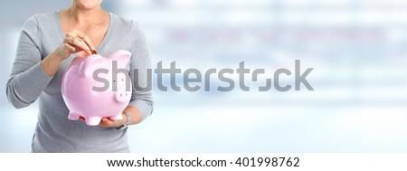 Woman hands with a piggy bank. - stock photo