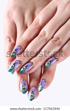 Woman hands with beautiful artistic nails ornament on a white - stock photo