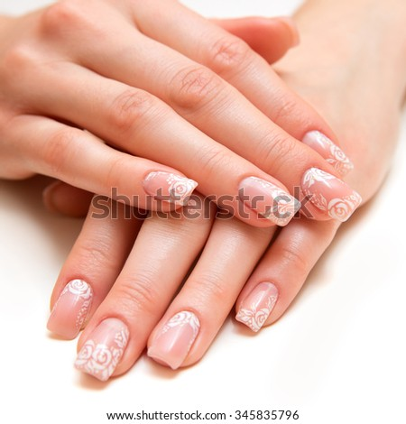 woman hands with beautiful fingernails - stock photo