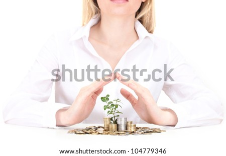 Woman hands with coins and plant isolated on white - stock photo