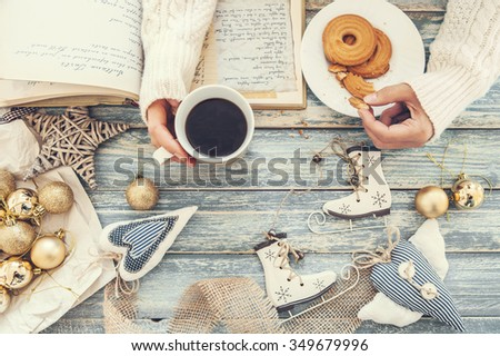 Woman hands with cookies and cup of hot coffee - stock photo