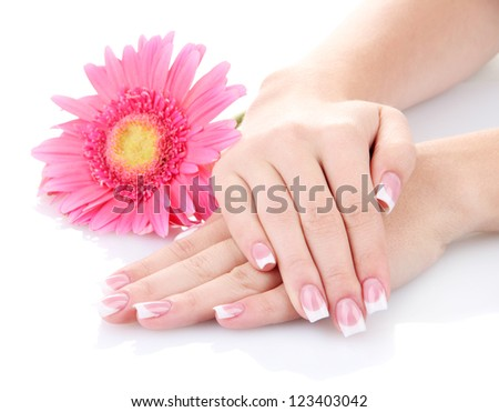 Woman hands with french manicure and flower isolated on white - stock photo