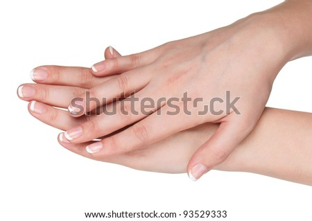 Woman hands with french manicure isolated on white background