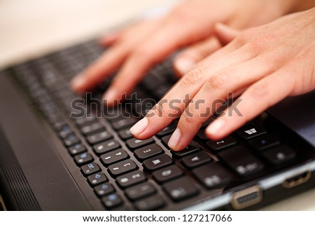 Woman hands with french manicure on keyboard - stock photo