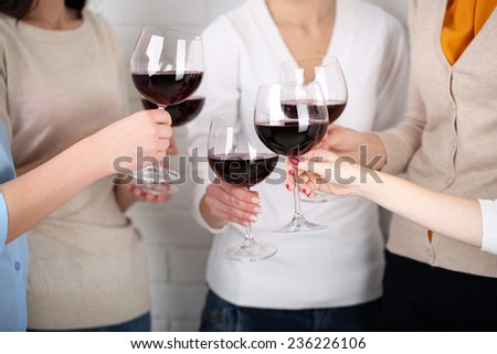 Woman hands with glasses of wine close-up - stock photo