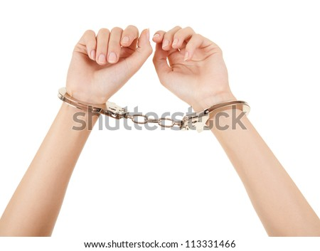 woman hands with handcuffs on the white background - stock photo