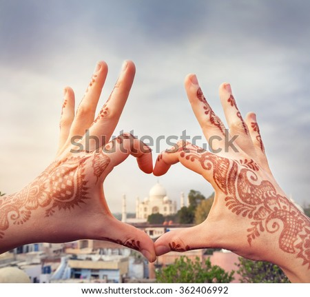 Woman hands with henna painting in shape of heart with Taj Mahal in it. I love India concept with copy space. - stock photo