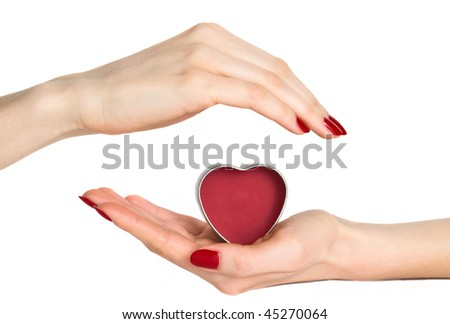 Woman hands with red manicure holding small heart isolated on white