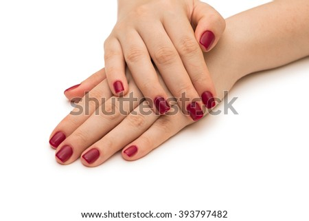 Woman hands with red nail isolated on white - stock photo