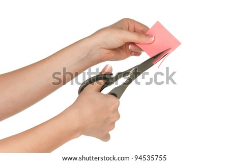 Woman hands with scissors isolated on white background - stock photo