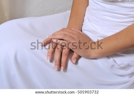 Woman hands with white dress
