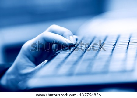 woman hands working on keyboard