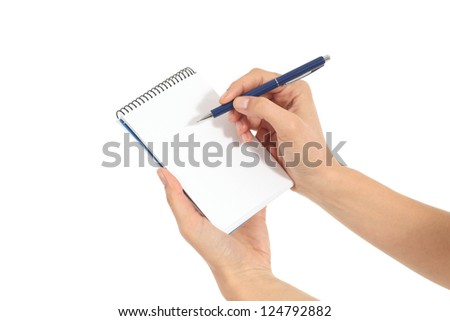 Woman hands writing on a notebook in a white isolated background