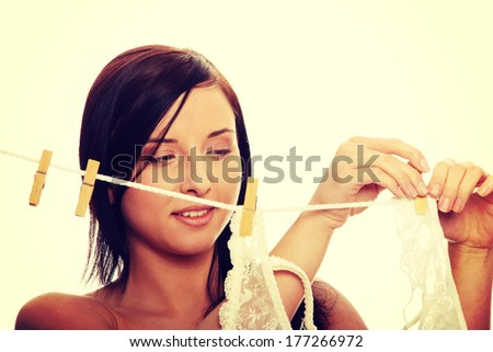 Woman hanging clothes on line