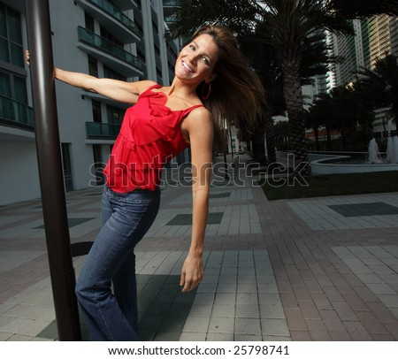 Woman hanging from a pole - stock photo