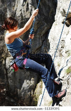 woman hanging with climbing rope - stock photo