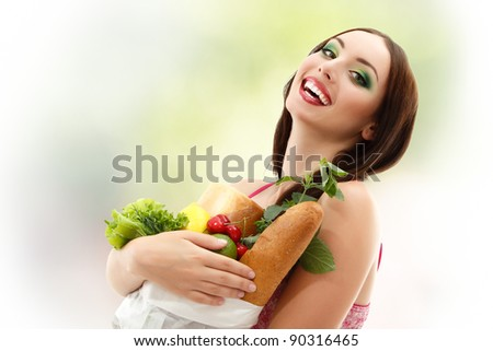woman happy holding food bag smiling attractive - stock photo