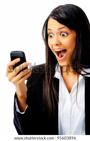 woman has a reaction of surprise as she reads a message on her mobile phone, isolated on white. - stock photo