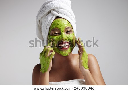 woman have fun with a face mask - stock photo