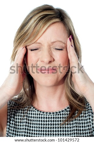 Woman having a bad headache, closeup
