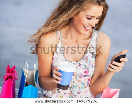 Woman having a break from shopping - stock photo