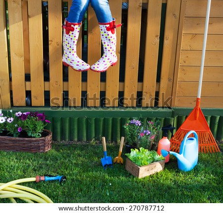 Woman having a break while working in the garden - stock photo