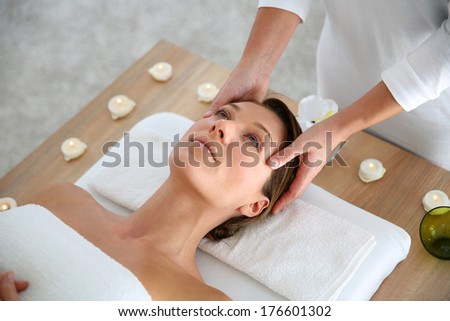 Woman having a face massage in beauty institute - stock photo