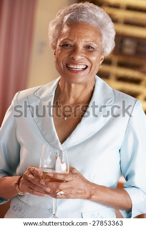 Woman Having A Glass Of Wine At A Bar