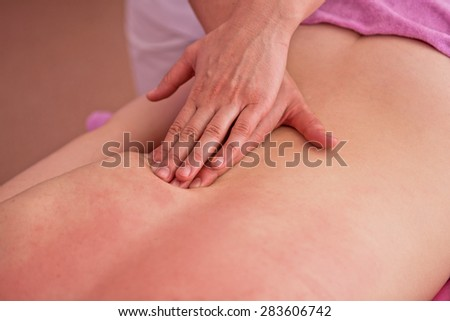Woman having a massage at spa - stock photo