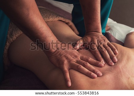 Woman having a massage at spa