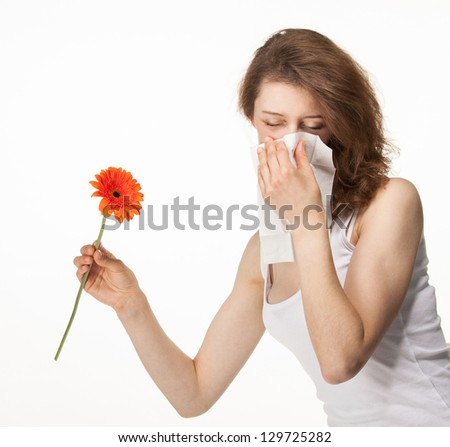 Woman having allergy from spring flowers isolated on white background - stock photo