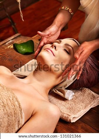 Woman having facial  ayurveda spa treatment. - stock photo