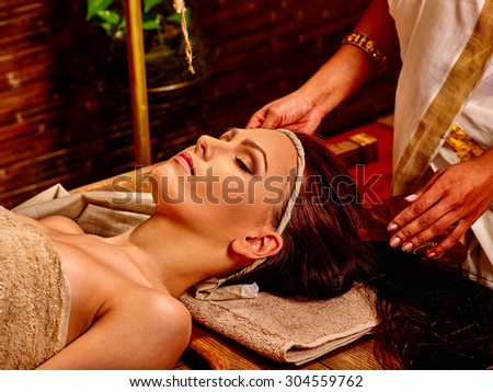 Woman having facial  ayurveda treatment. Eyes closed.Spa resorts in India - stock photo